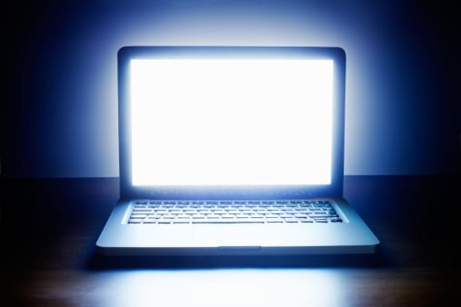 Laptop screen glowing brightly
